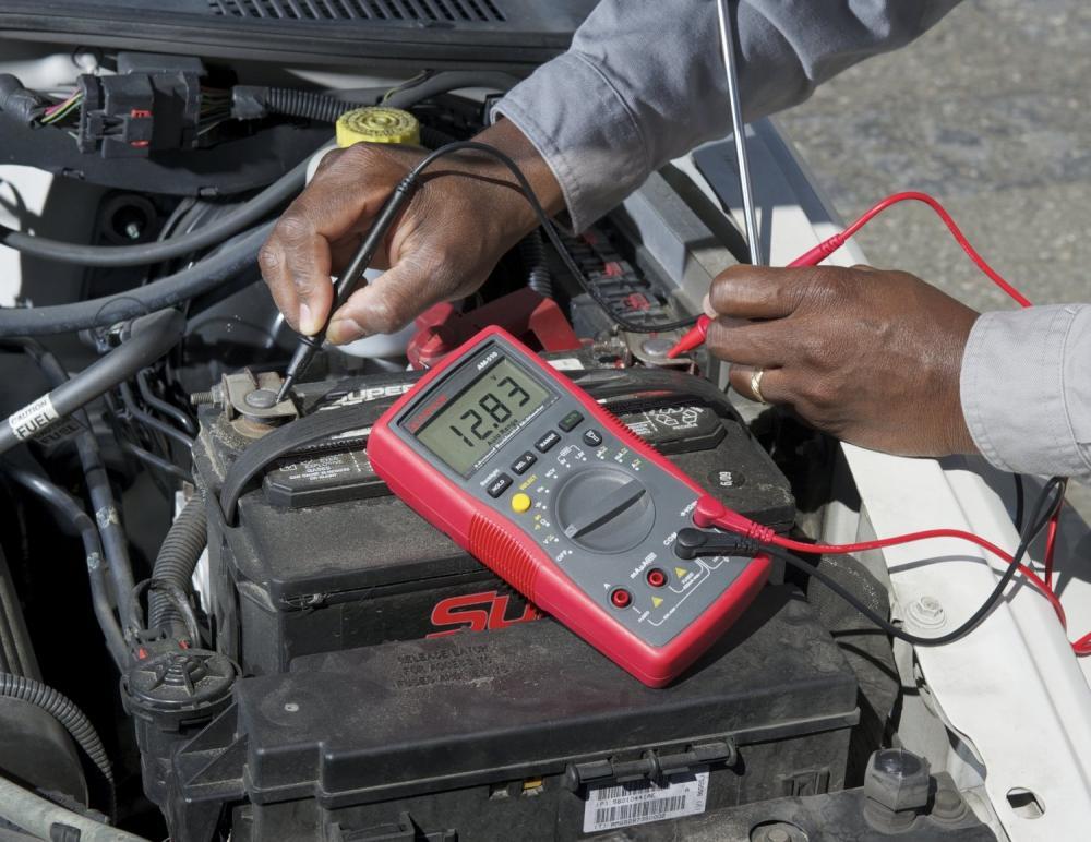 a man fixing a car battery