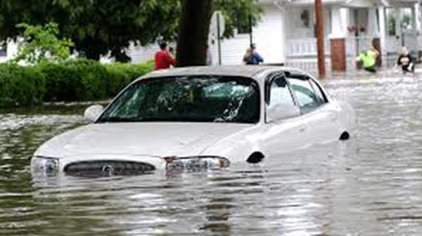 A car driving through flooded water
