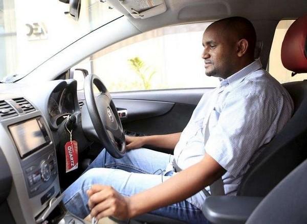 African man driving car