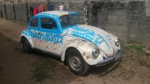 an abandoned Volkswagen Beetle
