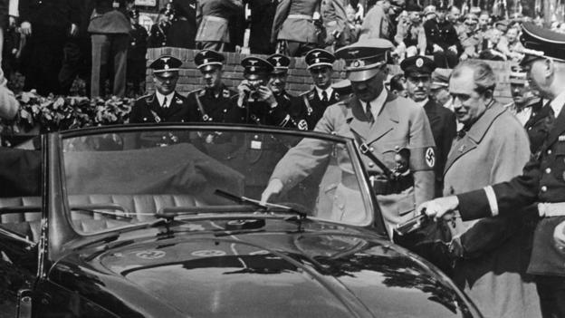 an-old-photo-with-hitler-and-a-beetle