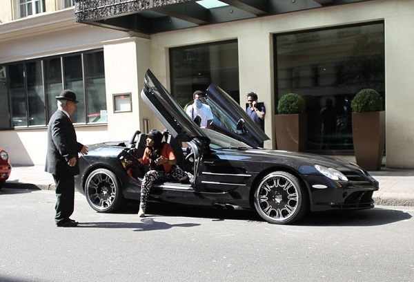 Obafemi-Martins-standing-next-to-his-Mclaren-SLR-convertible