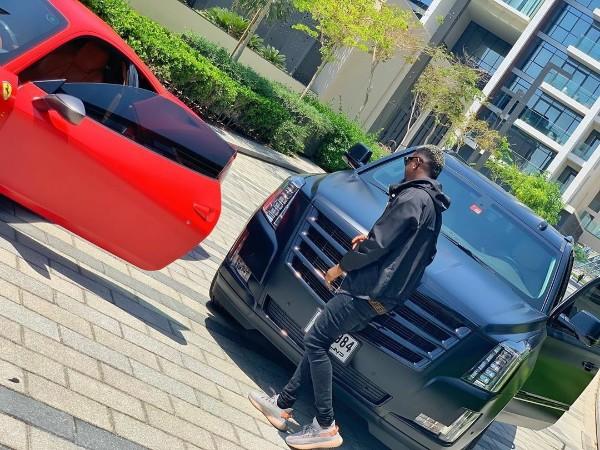 BNaira-with-his-Matte-Black-Cadillac-Escalade