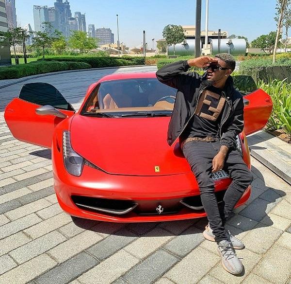 BNaira-with-his-Red-Ferrari-Sportscar