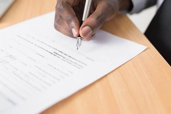 black-man-signing-a-paper
