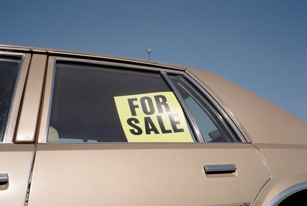 car-with-sale-sign-on-it