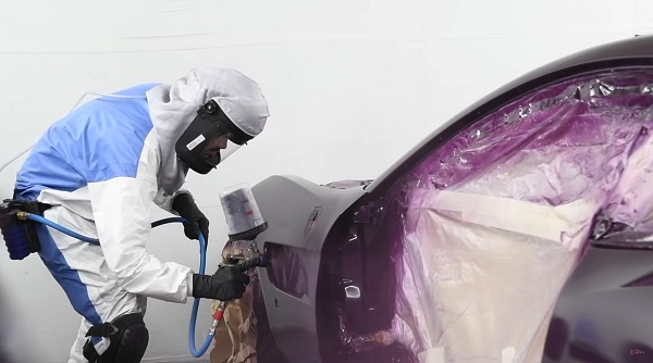 image-of-/watch-jay-kays-ferrari-gtc4lusso-being-painted-purple