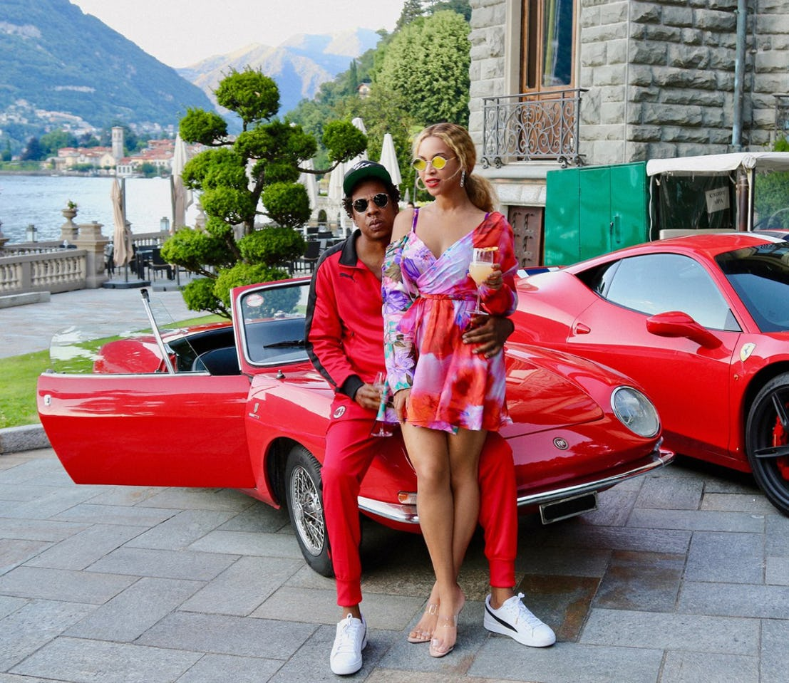 Jay-Z-and-Beyonce-with-their-red-convertibles