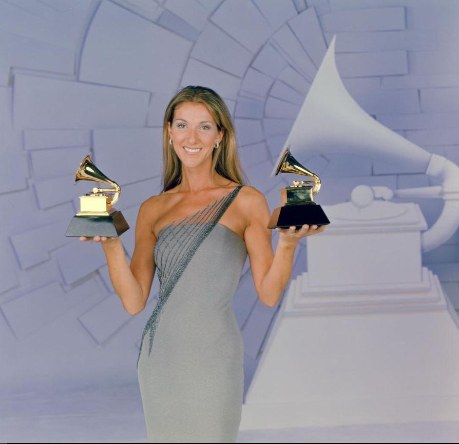 celine-dion-holding-2-grammy-awards
