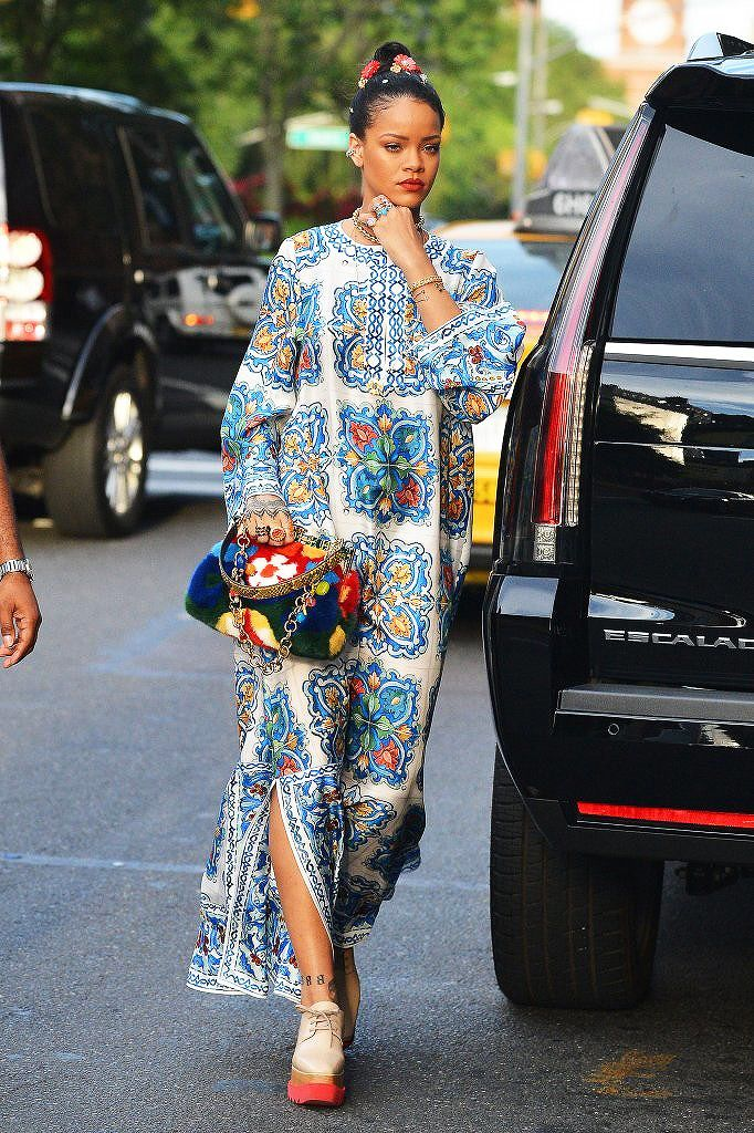 Rihanna stepping out of her Escalade