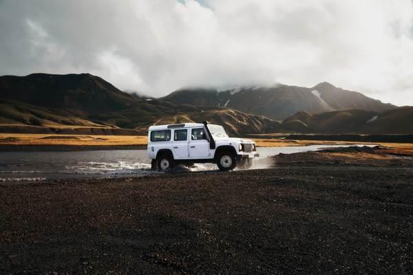 white-car-off-roading
