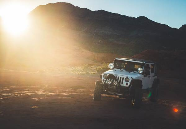 white-jeep-off-roading