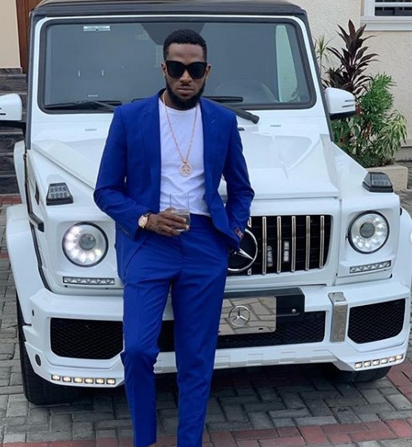 d'banj-in-front-of-his-G-wagon
