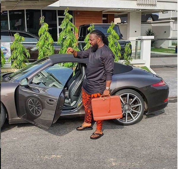 Timaya-getting-into-his-supercar