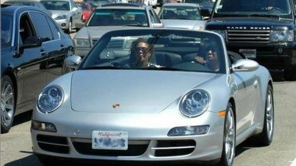 image-of-/jay-z-and-beyonce-in-porsche-911-carrera-cabriolet