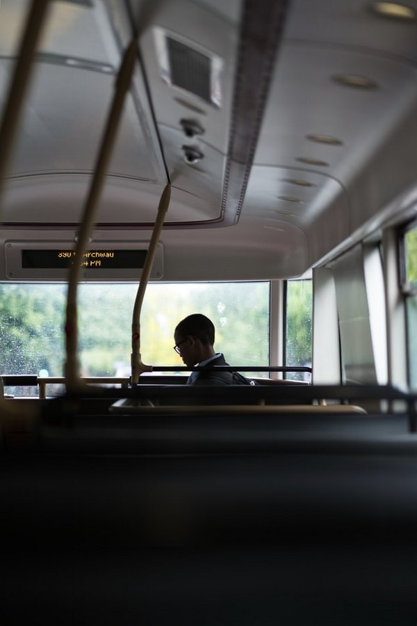 an-african-boy-getting-into-a-bus