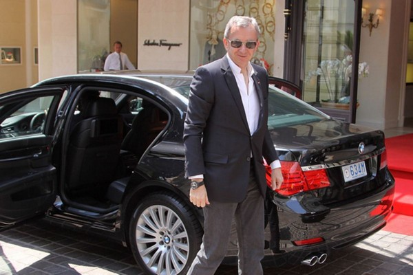 bernard-arnault-stepping-out-of-his-bmw-