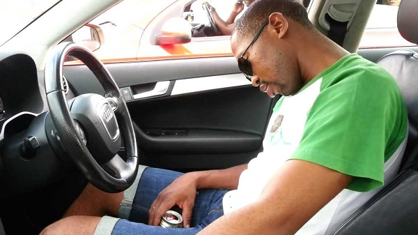 Drunk-black-guy-passed-out-behind-the-wheels