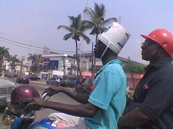 nigerian-wearing-bucket-instead-of-helmet