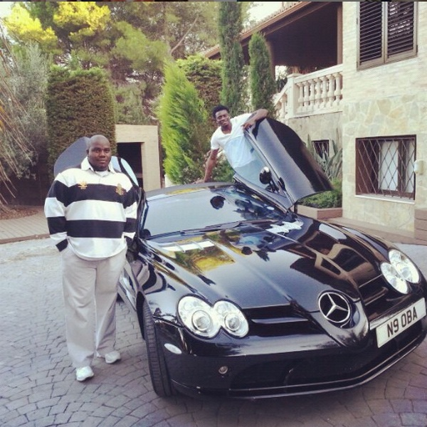 obafemi-posing-with-his-SLR-McLaren