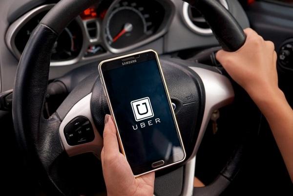 man-using-uber-while-driving