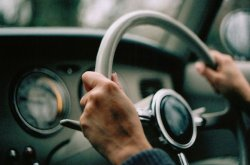 Hands-laid-on-the-steering-wheel