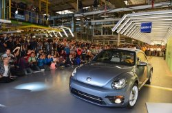Glorious exit! Volkswagen says goodbye to Beetle as it rolls out final edition