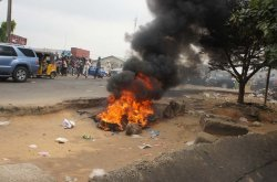 Angry mob sets 2 'one chance operators' & their cars ablaze in Abuja