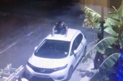 [Viewer discretion] Home CCTV catches unidentified man 'pooing' on couple's new Honda Jazz